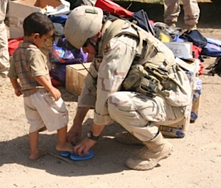 soldier-helps-child.jpg